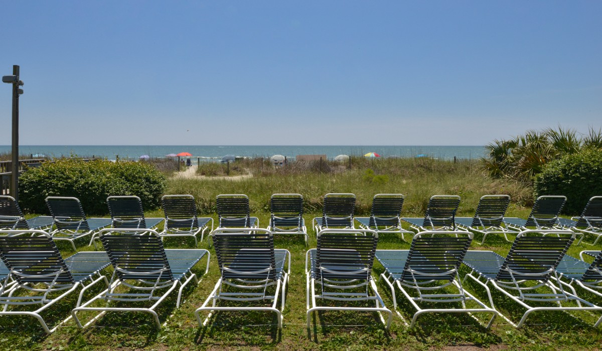 The Sea Horn Motel in Myrtle Beach - Beachfront chairs